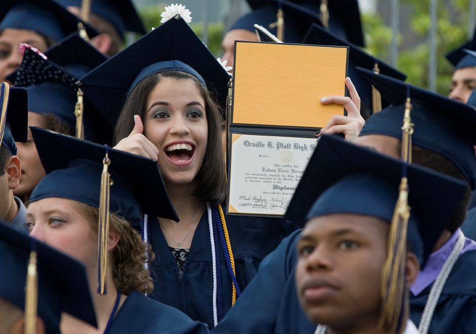 Graduate Tatiana Hernandez holds up her diploma for family members during graduation ceremonies at Platt High School in Meriden, Friday, June 19, 2015. | Dave Zajac / Record-Journal