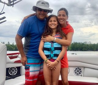 The Brandi family enjoys a day out on the water. Emelia (center) enjoys water sports such as paddleboarding, wakeboarding and surfing. Photo courtesy of Sarah Brandi.