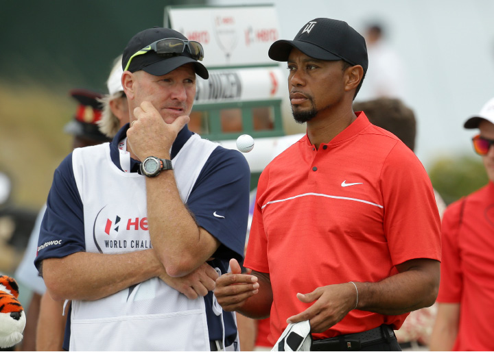 Tiger Woods waits with his caddie, Joe LaCava, to tee off on the second hole during the final round at the Hero World Challenge golf tournament, Sunday, Dec. 4, 2016, in Nassau, Bahamas. (AP Photo/Lynne Sladky)