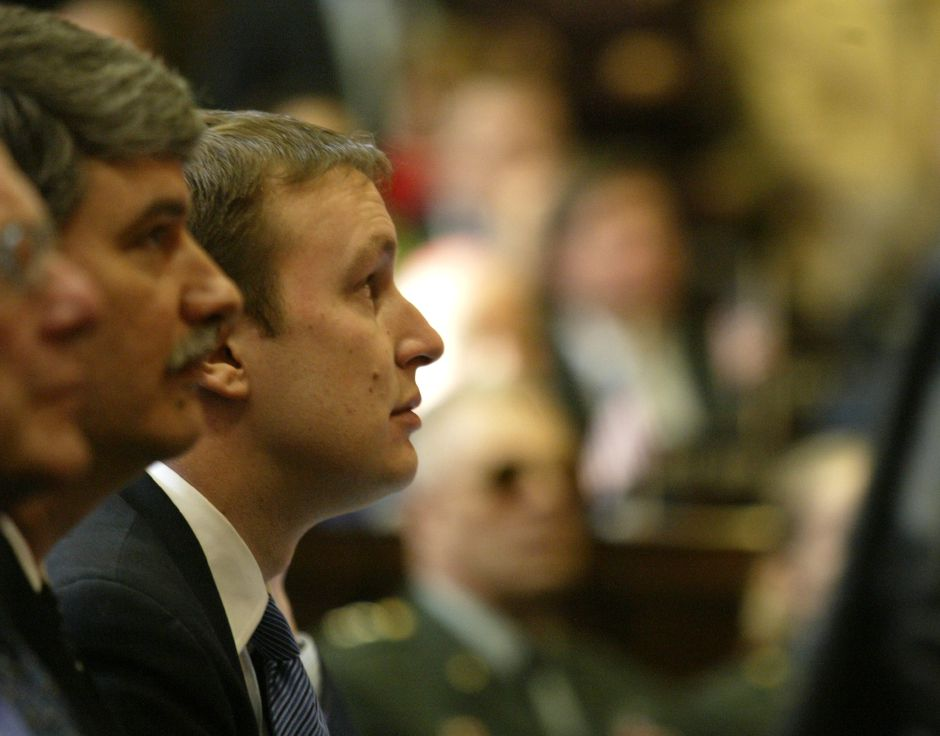 Senator Chris S. Murphy (D) listens as CT Governor John G. Rowland delivers the State of the State address Wednesday at the capitol in Hartford.