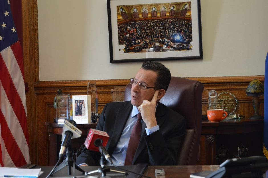 FILE PHOTO –  Gov. Dannel P. Malloy talks with reporters in his office at the Capitol during the 2017 legislative session (file photo). | Mike Savino, Record-Journal
