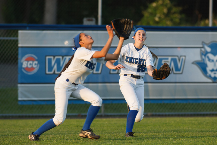 Southington's Caroline Burke (3) and Emily Lippincott (26) run for a pop fly Saturday during a clall LL final with Amity at DeLuca Field in West Haven June,14 2014 | Justin Weekes / For the Record-Journal
