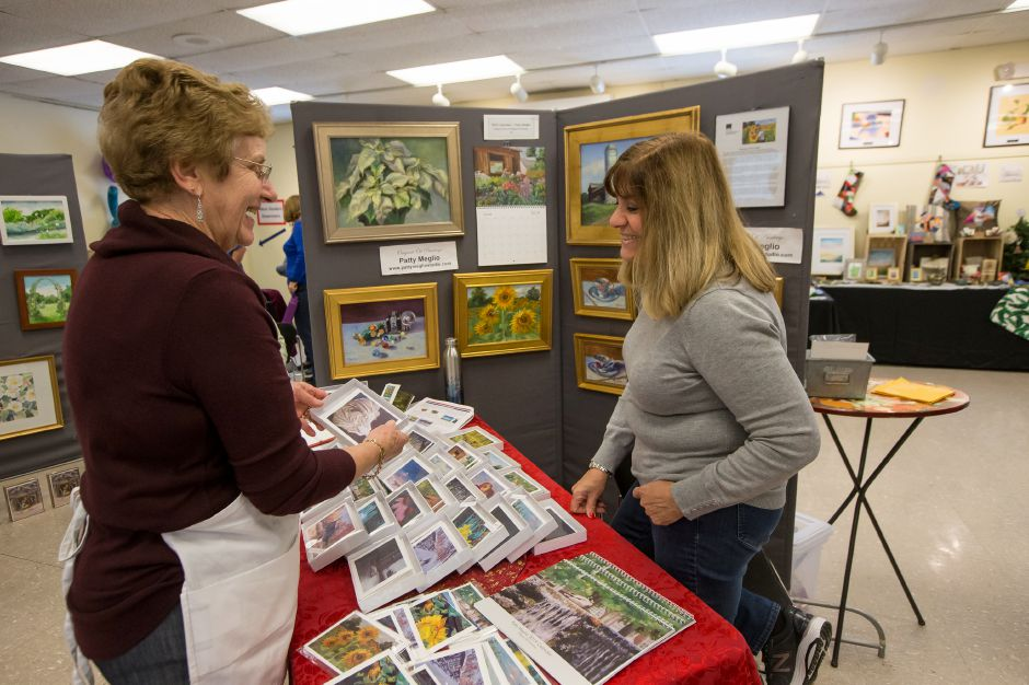 Jean Butterworth of Maryland talks with artist Patty Meglio of North Branford Sunday during the Artspace Marketplace at Artspace in Cheshire. November 18, 2018 | Justin Weekes / Special to the Record-Journal