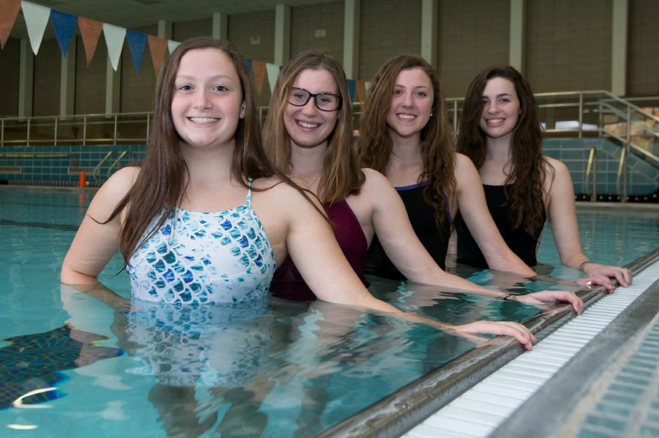 Lyman Hall swimmers (left to right) Faith Gambardella, Nicole Cislo, Sarah Beverage and Katie Driscoll combined to finish second in the 200 medley relay at Wednesday's CIAC Class M championship meet at SCSU. They made All-State and qualified for Saturday's State Open at Yale. | Justin Weekes / For the Record-Journal