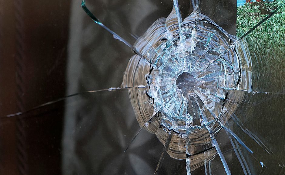 Damage to the front window of Red Room Grille on North Colony Street in Meriden, Tuesday, Nov. 21, 2017. The state Department of Consumer Protection has issued the business a summary suspension after a man was injured in a shooting at the establishment early Saturday. | Dave Zajac, Record-Journal