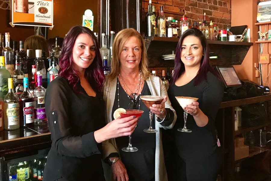From left, bartender Jenn Finn, of Wallingford, owner Lynn Moran, of Durham, and bartender Brittney Frazier, of Waterbury, show off martinis at Jake's, 179 Center St., Wallingford. Ashley Kus, Record-Journal