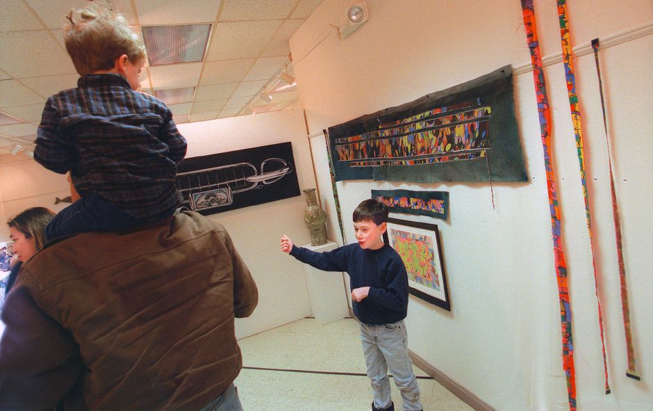 RJ file photo - Christopher Fagan, 10, of Woodbury, right, draws attention to his mother Ellan Fagan