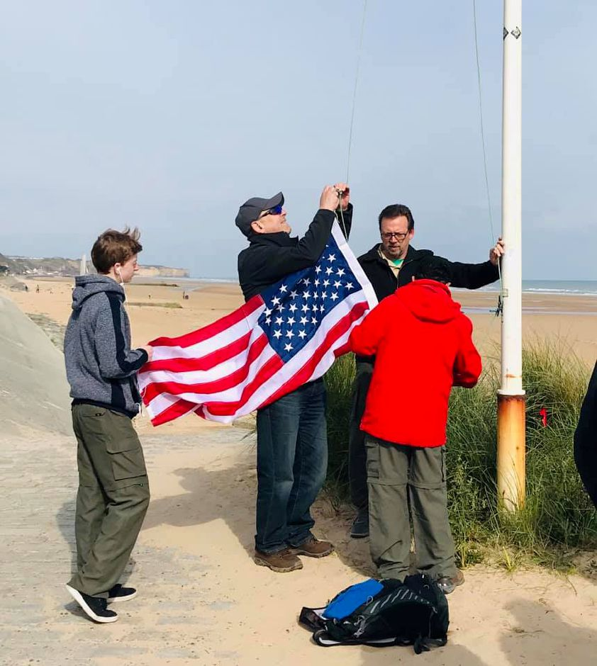 Boy Scout Troop 270 of Durham in Normandy in April 2019, raising a flag over Omaha Beach. | Photo Courtesy Don Poggio, Troop Leader