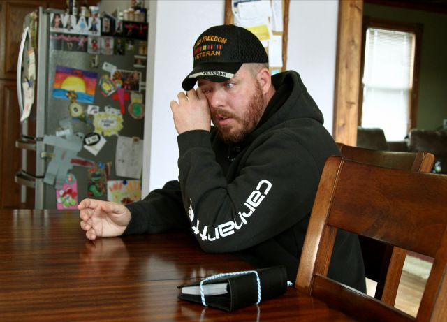 In this Nov. 1, 2019, photo, Gabe Steele wipes his eye as he sits in his home in West Point, Iowa, and talks about the accidental fatal shooting of his wife, Autumn Steele, by a Burlington, Iowa police officer in 2015. Accidental shootings by police happen across the United States every year, an Associated Press investigation has found, and experts say it