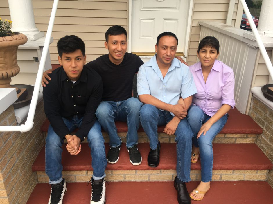 File photo – Brothers Erick and Jason Ramos, at left, sit with their parents Franklin and Gioconda at their Cook Avenue home on Thursday, Aug. 10, 2017. Franklin and Gioconda, who entered the country illegally over two decades ago, must leave their home and children behind after a stay request was denied.