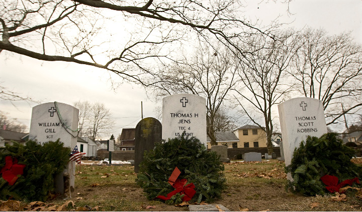 Wreaths placed on veterans graves left to right, William J. Gill, Thomas H. Jens and Thomas Scott Robbins at Center Street Cemetery in Wallingford, Wednesday, December 21, 2016. Each December Wreaths Across America  coordinates wreath-laying ceremonies at Arlington National Cemetery, as well as over 1,100 additional locations in all 50 U.S. states, at sea, and abroad.  | Dave Zajac, Record-Journal