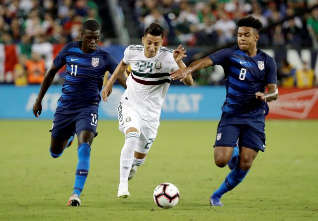 Mexico midfielder Roberto Alvarado (24) dribbles the ball past U.S. midfielders Tim Weah (11) and Weston McKennie (8) during an international friendly match, Tuesday, Sept. 11, 2018, in Nashville, Tenn. (AP Photo/Mark Humphrey)