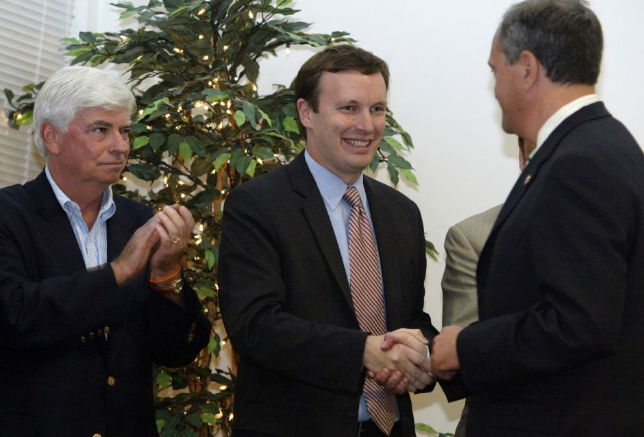 Chris Murphy, center, shakes the hand of Democratic candidate for Governor John DeStefano, right, as Sen. Chris Dodd (D-Conn.) applauds during a campaign stop at the Curtis Cultural Center in Meriden, Conn. on Saturday, August 19, 2006.