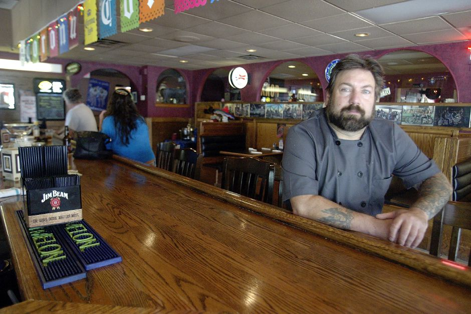 Frank Petrone, co-owner of Pig Out BBQ Restaurant on Eden Ave. in Southington., sits at the bar for a photograph on May 24, 2006. Not pictured is co-owner Richard Zoccoli. The co-owners opened up this restaurant an closed one in Plymouth because the Southington location has been more popular.