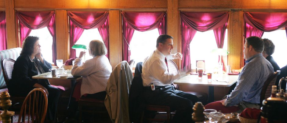 Patrons of the Yankee Silversmith Inn eat lunch in the parlor car Wednesday afternoon October 12, 2005. Chris Angileri/Record-Journal.