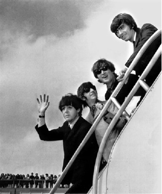 ** HOLD FOR RELEASE UNTIL 12:01 EDT WEDNESDAY AUG. 12, 2009 ** In this Sept. 21, 1964, file photo The Beatles, from left, Paul McCartney, Ringo Starr, John Lennon and George Harrison board a plane for England at a New York airport with some of their fans in the background.  A new poll by the Pew Research Center examining the generation gap four decades after Woodstock and the rebel yell of 1960s youth finds that rock and roll rules across generations and the Beatles are high on the list of every age group