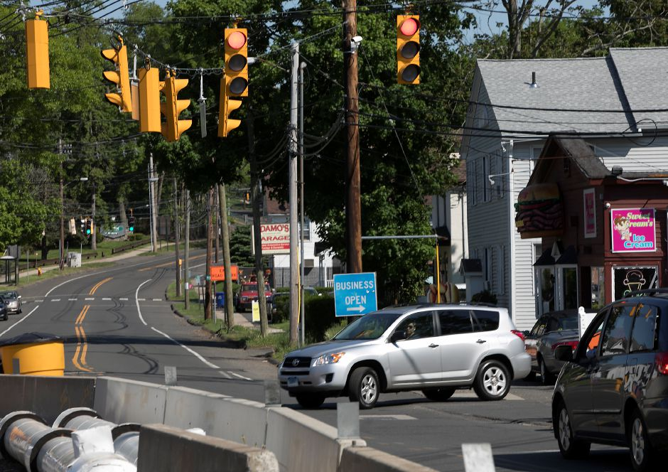 A motorist pulls out of a local business at the East Center Street bridge under construction in Wallingford, Thursday, May 24, 2018. Completion of the bridge could be delayed up to a year past the original completion date of November. Dave Zajac, Record-Journal