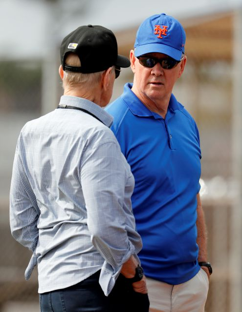 New York Mets general manager Sandy Alderson, right, talks with owner Fred Wilpon during spring training baseball practice Tuesday, Feb. 13, 2018, in Port St. Lucie, Fla. (AP Photo/Jeff Roberson)