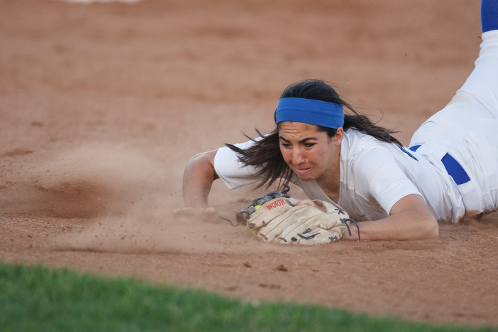 Southington's Syndney Ferrante (13) dives for a grounder Saturday during a class LL final with Amity at DeLuca Field in West Haven June,14 2014 | Justin Weekes / For the Record-Journal