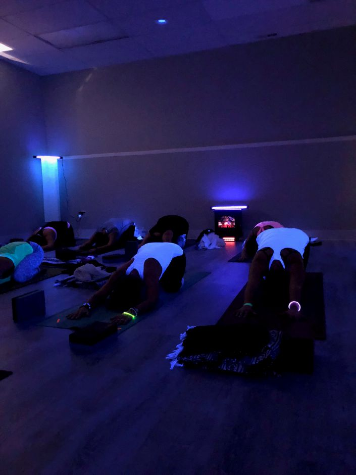 A previous black light yoga class at Rise Yoga, 220 N. Colony Rd., Wallingford. |Courtesy of Kelsey Sperl