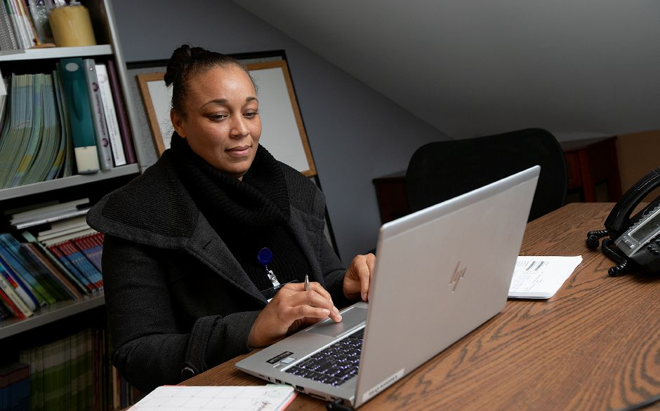 Leonora Ortiz, a community health worker, works at her desk at Community Health Center on State Street in Meriden, Wed., Jan. 23, 2019. Community Health Center Inc. has launched a community health worker pilot program. Dave Zajac, Record-Journal