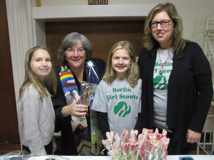 Members of Girl Scout Troop 66185 held a bake sale at Berlin Congregational Church recently following morning services. From left: Krista Blackely, Rev. Pamela Vollinger, Jennifer Hansen and Jill Hansen.