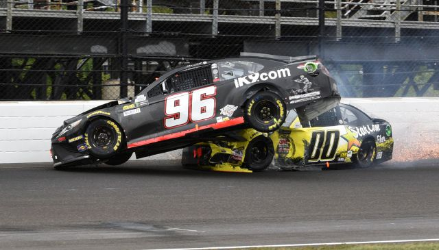 The car driven by NASCAR Cup Series driver Jeffrey Earnhardt (96) and driver Landon Cassill (00) crash in the third turn during the NASCAR Brickyard 400 auto race at Indianapolis Motor Speedway in Indianapolis Monday, Sept. 10, 2018. (AP Photo/Mike Alley)