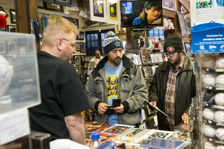 Chris Belline left and Bob Bergeron both of Norwalk pick hero cards of pro wrestler Kevin Nash to sign from John Kelleher Saturday at M & J Video Game and First Base Collectables in Wallingford Jan. 30, 2016 | Justin Weekes / For the Record-Journal
