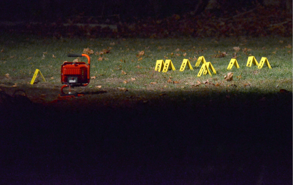 Evidence markers sit in front of a house at 380 Main St. in South Meriden, Monday, Nov. 16, 2015. Shots were fired at the nearby Baitul Aman Mosque over the weekend at 410 Main St. l Bryan Lipiner / Record-Journal