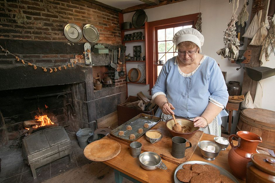 Curator Karen Keene prepares cookies for baking at the 1711 Solomon Goffe House, 677 N. Colony St., Meriden. The oldest house in Meriden is listed on the National Register of Historic Places. Photos by Dave Zajac, Record-Journal