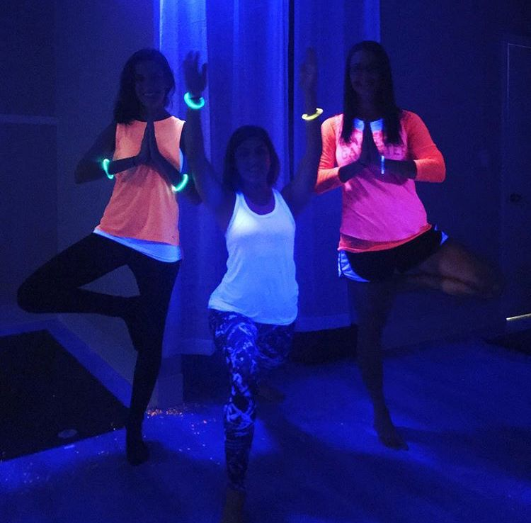 A  black light yoga class at Rise Yoga, 220 N. Colony Rd., Wallingford. Kelsey Sperl