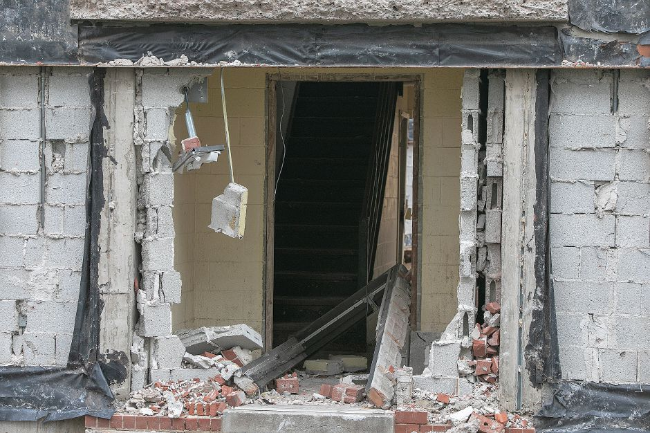 One of the many windows demolished on the former Mills Memorial Apartments on Mill Street in Meriden, Monday, Sept. 24, 2018. Dave Zajac, Record-Journal