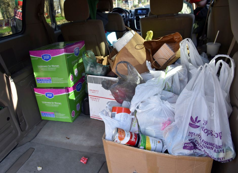 An almost-packed car of donations collected while going door-to-door during the 13th annual Community Round-up in Durham and Middlefield on Saturday, Dec. 1, 2018. The event collected more than 13,000 food items and about $3,500 to go to Durham and Middlefield Social Services, and Amazing Grace in Middletown. | Bailey Wright, Record-Journal
