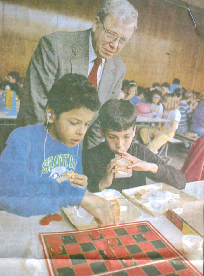 Thomas Hooker school principal Thomas Hall watches students play checkers in 1992. | Record-Journal archives
