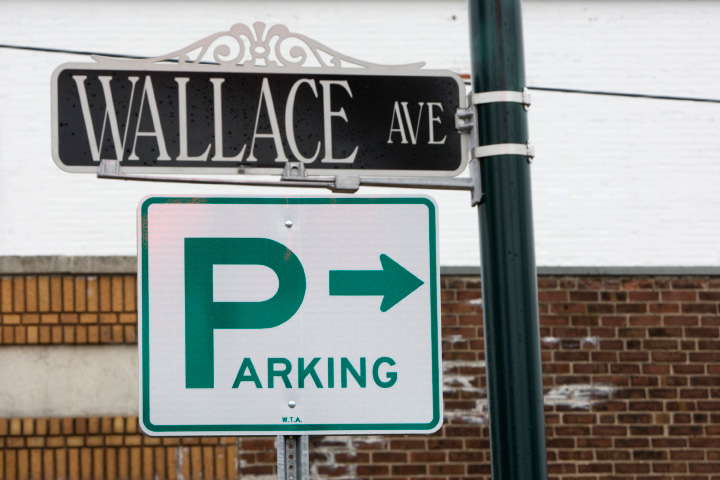A sign post points to public parking along Wallace Ave. and the Wooding-Caplan property in Wallingford, Friday, March 28, 2014.  |  Dave Zajac / Record-Journal