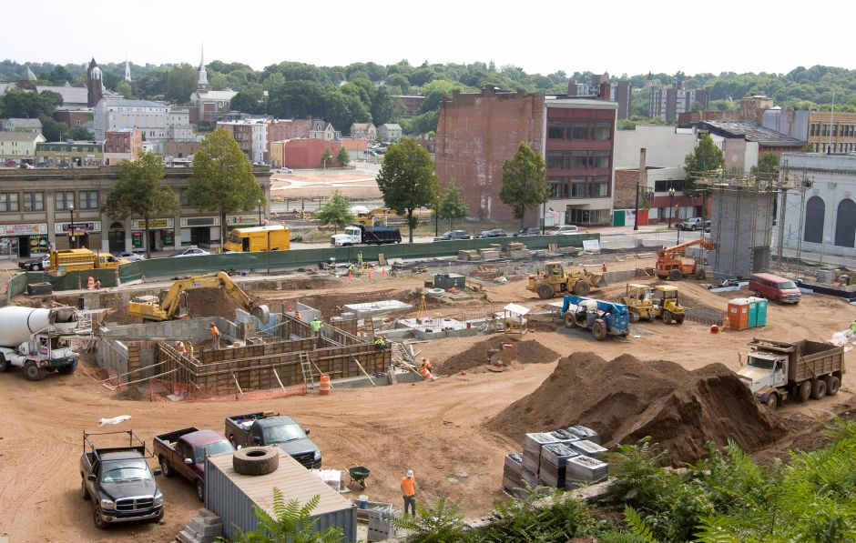 Work progressing on a new building at 24 Colony St. in Meriden, Friday, September 4, 2015. The $24 million mixed-use residential building will include 63 apartments and more than 11,000 square feet of commercial and retail space, as well as a $8.3 million 275-space parking garage overseen by the state Department of Transportation. | Dave Zajac / Record-Journal