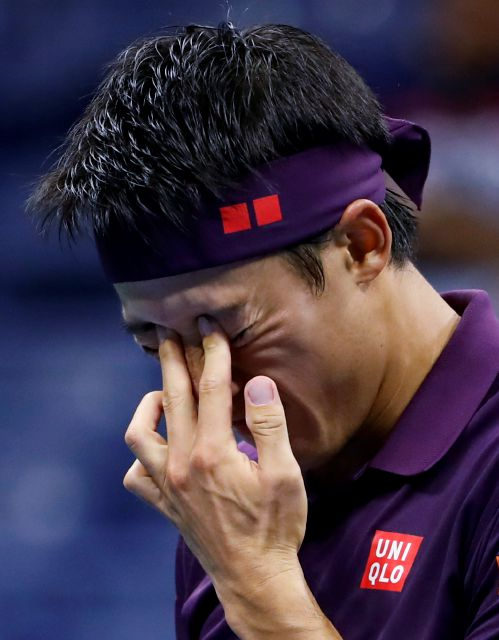 Kei Nishikori, of Japan, reacts after missing a shot against Novak Djokovic, of Serbia, during the semifinals of the U.S. Open tennis tournament, Friday, Sept. 7, 2018, in New York. (AP Photo/Adam Hunger)