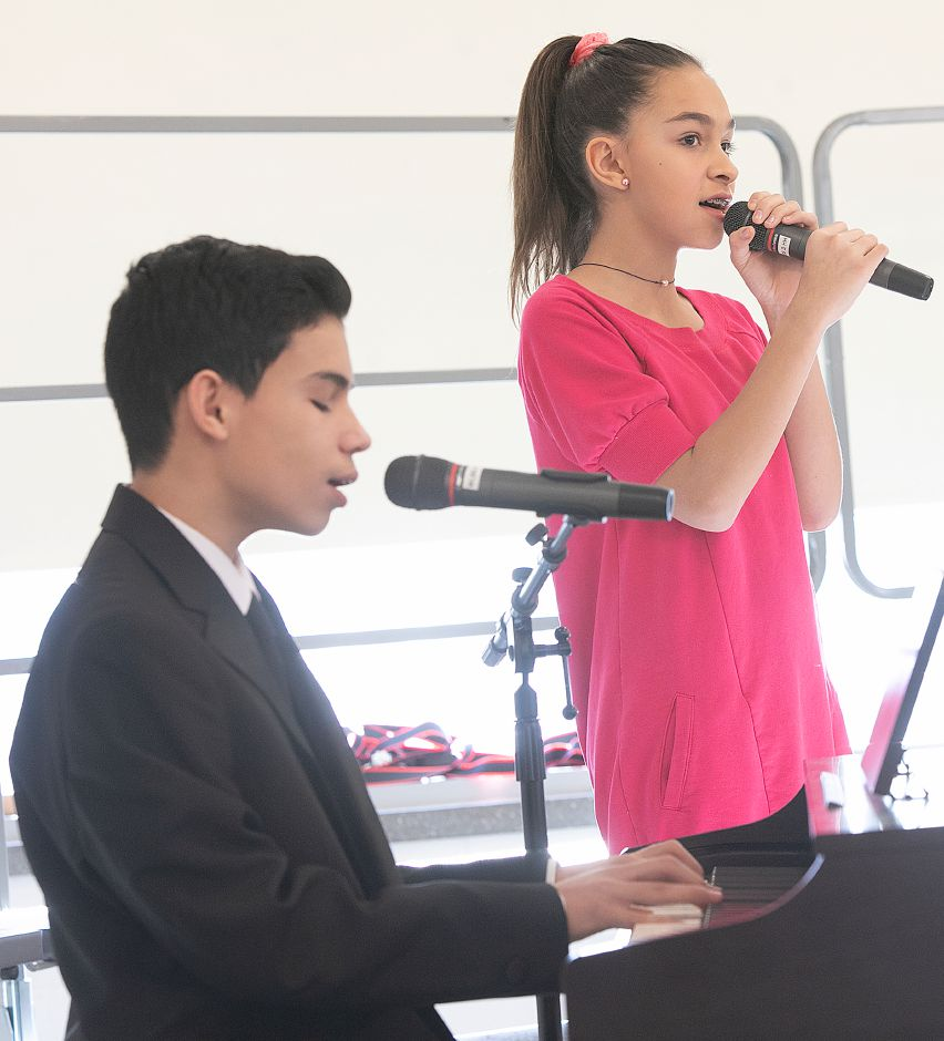 "Miguel Cardona, 14, and sister Celine, 12, of Meriden, perform the song ""Shallow"" during the 34th annual Martin Luther King Jr./Albert Owens scholarship breakfast at Maloney High School, Mon., Jan. 21, 2019. Dave Zajac, Record-Journal"