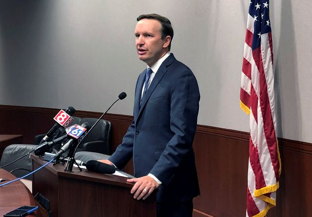 U.S. Sen. Chris Murphy speaks during a news conference, Friday, Aug. 23, 2019, in Hartford, Conn. Murphy said White House officials told him on Thursday that President Donald Trump remains committed to working on expanded background checks legislation for gun purchases. (AP Photo/Susan Haigh)