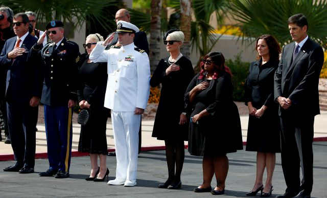 The family of Sen. John McCain, R-Ariz., from left, son Doug McCain, son Jimmy McCain, daughter Meghan McCain, son Jack McCain. wife Cindy McCain, daughter Bridget McCain, daughter Sidney McCain and son Andrew McCain watch as McCain