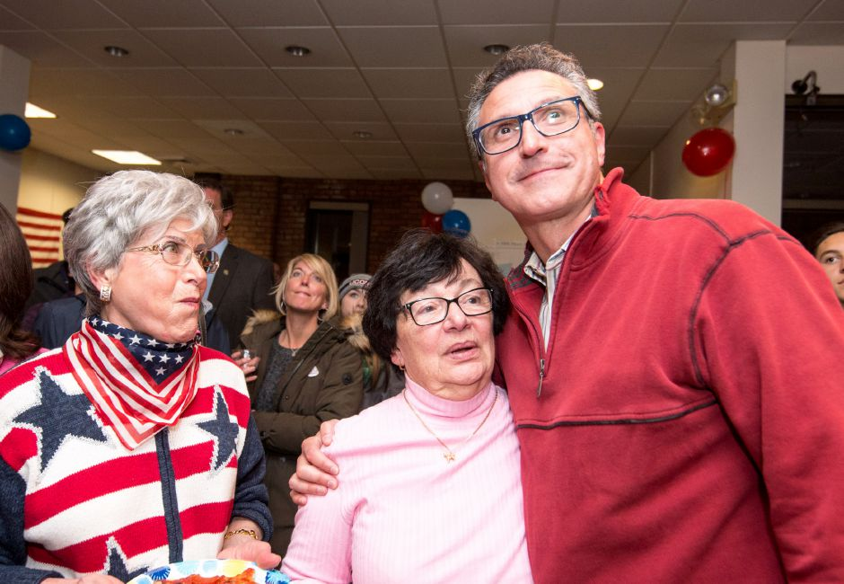 Republican mayoral candidate Irene Mass stands with Republican at large city councilor candidate Manny Santos at the Republican campaign headquarters. The unofficial poll results predict both candidates