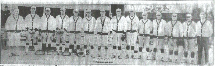 "Photo: Recognize any of these players? A reader brought in this wonderful old baseball photo in 2005. It is signed in the lower right hand corner ""Shaw"" and the date of 1926. We wonder if anyone recognizes any of these folks. Barbara Oppeit from Meriden says she found it in her attic and knows the second person from the left, Ernest Dahike. And now someone who believes his grandfather, Curly williams is also in the photo."