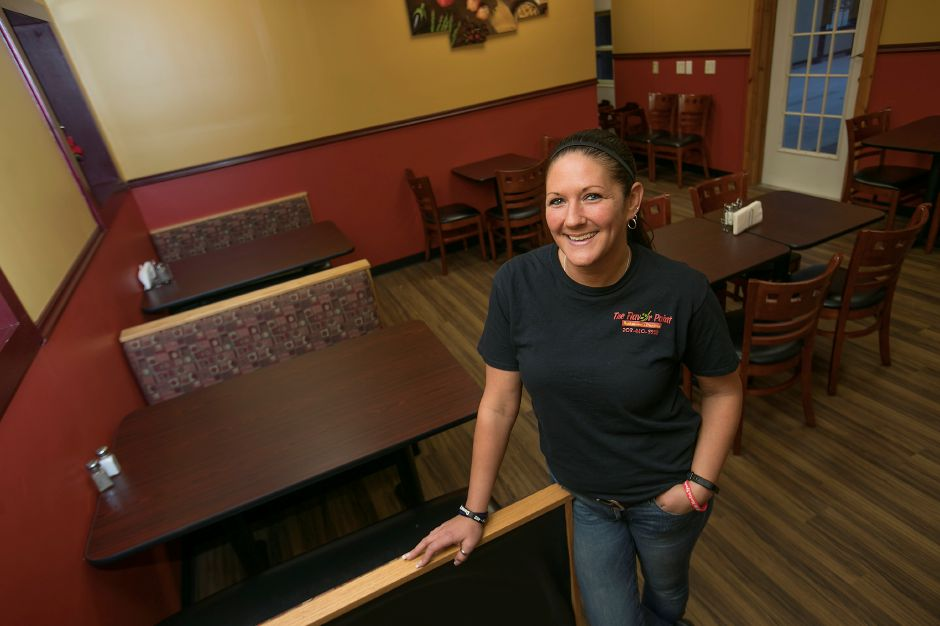 Sarah Armstrong, manager, stands in the dining room of The Flavor Point, a new restaurant at 587 Hanover Rd. in Meriden, Tuesday, Jan. 16, 2018. Dave Zajac, Record-Journal