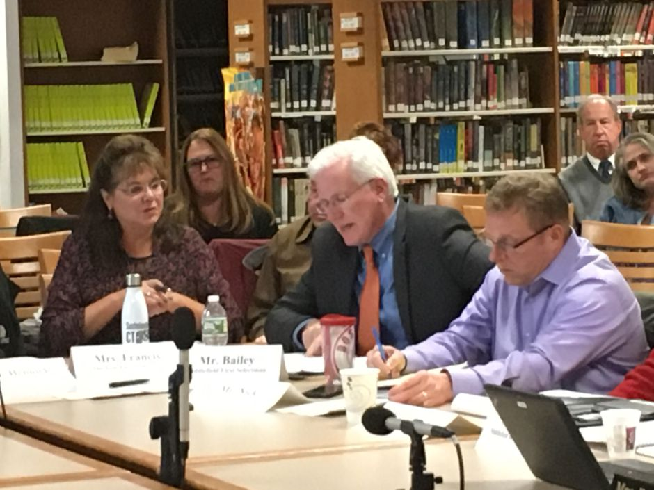 Durham First Selectman Laura Francis and Middlefield First Selectman Ed Bailey discuss Regional School District 13's budget in light of the finalized state budget at Coginchaug Regional High School on Wednesday. Lauren Takores, Record-Journal