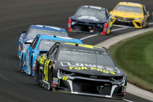 NASCAR Cup Series driver Jimmie Johnson (48) drives through the first turn during the NASCAR Brickyard 400 auto race at Indianapolis Motor Speedway, in Indianapolis Monday, Sept. 10, 2018. (AP Photo/AJ Mast)