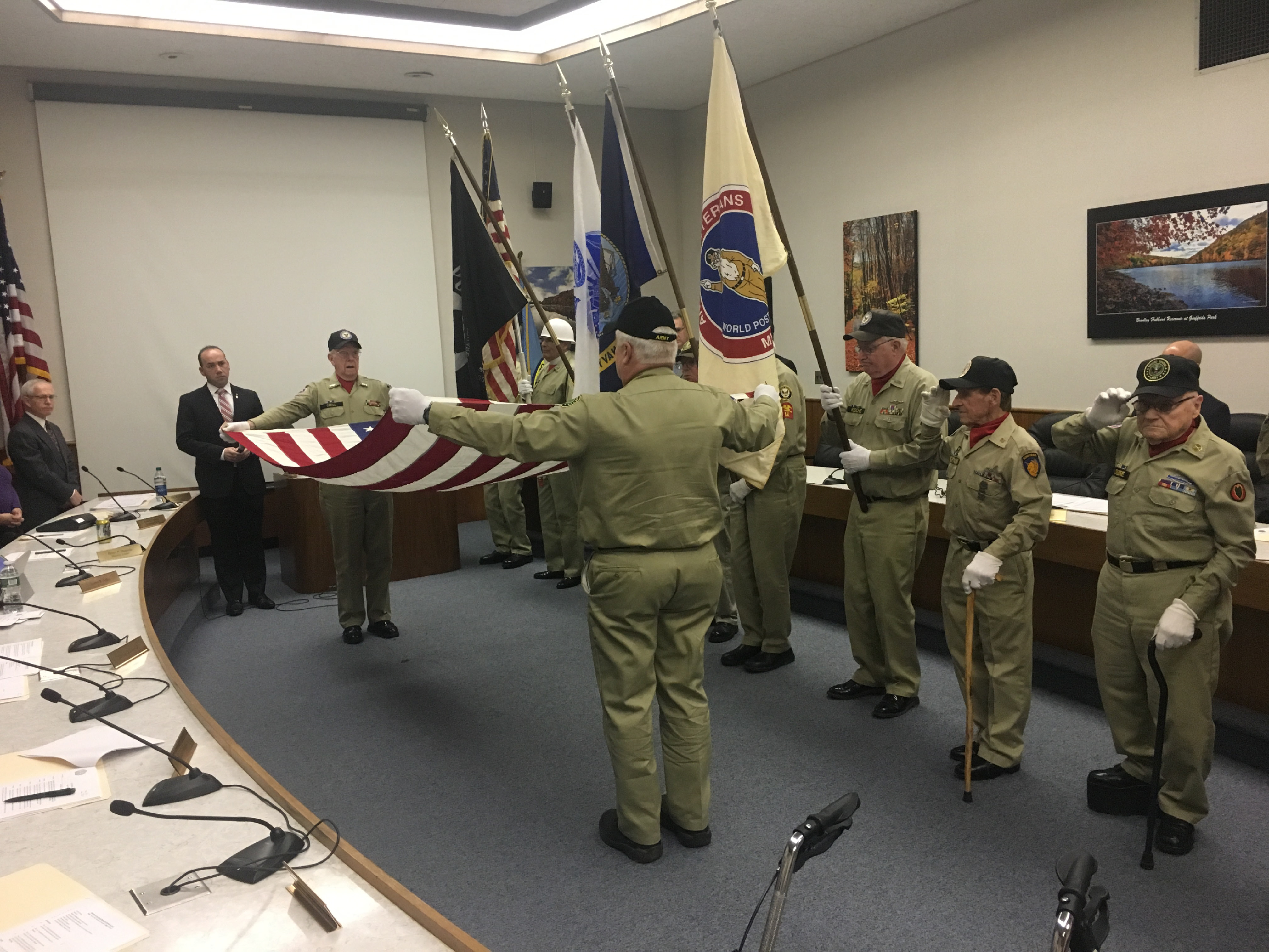 Meriden Antique Veterans demonstrate the service they provide at funerals at the Meriden City Council meeting, Monday, Feb. 6, 2017. | Leigh Tauss, Record-Journal