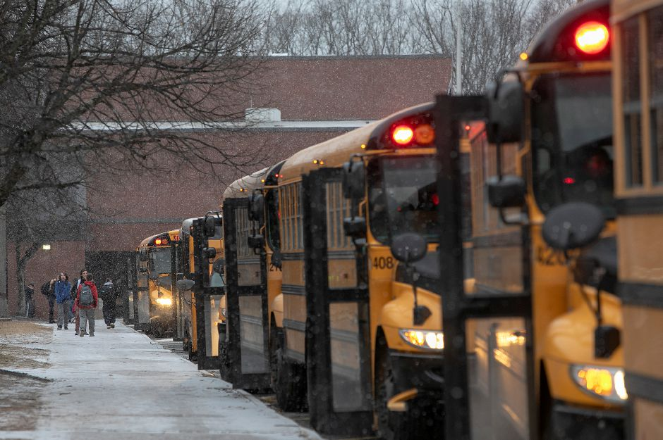 Students walk to their buses at the end of the school day at Southington High School in 2018. File photo, Record-Journal