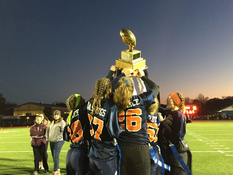 Lyman Hall powder puff players hold their trophy high after winning the 46th annual Samaha Bowl on Wednesday at Fitzgerald Field at Lyman Hall. | Bailey Wright, Record-Journal