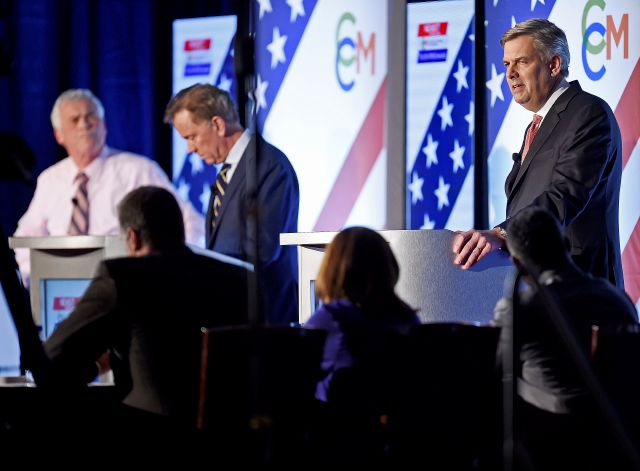 Republican candidate Bob Stefanowski, right, answers a question as he and the other two leading candidates for Connecticut Governor; Democrat Ned Lamont, center, and petitioning candidate Oz Griebel, left, face off in their final gubernatorial debate one week before the election Tuesday, Oct. 30, 2018 at at the Premier Ballroom at Foxwoods in Ledyard, Conn. (Sean D. Elliot/The Day via AP)