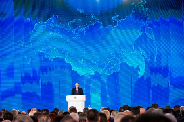 Russian President Vladimir Putin gives his annual state of the nation address in Manezh in Moscow, Russia, Thursday, March 1, 2018. Putin set a slew of ambitious economic goals, vowing to boost living standards, improve health care and education and build modern infrastructure in a state-of-the-nation address. (AP Photo/Alexander Zemlianichenko)